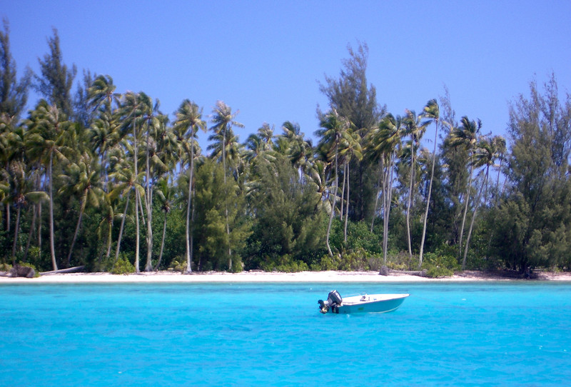 A boat floats in the Moorea lagoon