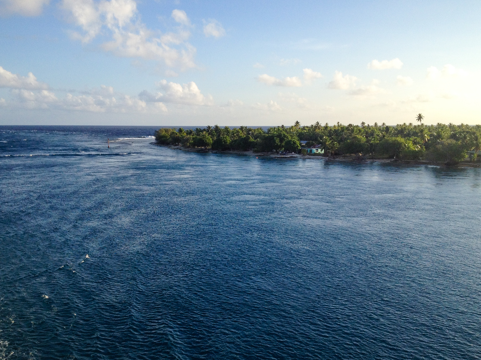 Blue water enters a pass into Rangiroa's lagoon.