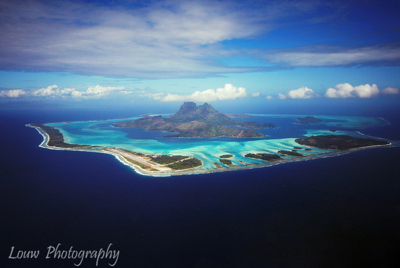 Aerial view of Bora Bora, French Polynesia by helicopter