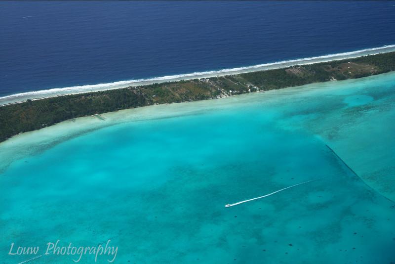 Solo boat in Bora Bora's lagoon, French Polynesia