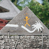 Warning sign next to coconut tree, Bora Bora, French Polynesia