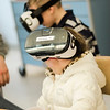 Cali, 3, and Aidyn Rapuano, 5, check out virtual reality headset during South Street Elementary School's annual science fair in Fitchburg on Saturday, April 8, 2017. SENTINEL & ENTERPRISE / Ashley Green