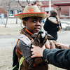 Barack Labah, 8, holds Blizzard, a one-month-old goat from 'Animal Craze' out of Winchedon, during South Street Elementary School's annual science fair in Fitchburg on Saturday, April 8, 2017. SENTINEL & ENTERPRISE / Ashley Green