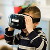 Aidyn Rapuano, 5, checks out a virtual reality headset during South Street Elementary School's annual science fair in Fitchburg on Saturday, April 8, 2017. SENTINEL & ENTERPRISE / Ashley Green