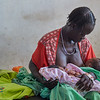 South Sudan. Mother with her new born twins.