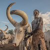 Mundari man with his cows