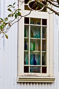 old bottles in the estancia window