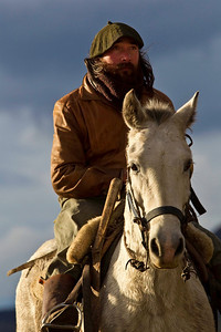 Gaucho in the saddle after a long day as the sun sets