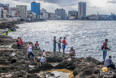 fishing along the malecon, habana