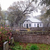 Strawberry Chapel and Childsbury Town<br /> <br /> Childsbury, one of the early towns to be laid out in South Carolina (1707), is significant as an important archaeological site. Englishman James Child started a ferry here as it was the only practical ferry site across the Cooper River within a reasonable distance. Property was designated for a college, a free school, a house for the schoolmaster, a place of worship, and a market square. To the inhabitants of Childsbury, Child gave 600 acres to farm and pasture. He also gave them the 100-acre hill by the river to build upon as a citadel to protect the town in times of war. Due mainly to the rise of the new and growing plantations, Childsbury began a rapid decline and the town site eventually became part of a plantation. Strawberry Chapel is the only visible remains of the town of Childsbury. Architecturally the chapel displays the simple, yet dignified and impressive lifestyle of an Episcopalian Chapel of Ease. This one story rectangular brick building has an unadorned hipped gable roof. The double three paneled door of the façade, surmounted by flush fanlight is symmetrically situated between two shuttered windows of the same three panel design. These chapels were built to serve the people for whom the regular parish church was inaccessible. Strawberry Chapel became unique as a Chapel of Ease in that it is operated as a full parish church. Usually these chapels were denied some of the privileges of a parish church. A small cemetery is adjacent to the chapel. Listed in the National Register April 26, 1972.