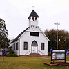 Pinopolis Historic District South (Pinopolis Methodist Church)<br /> <br /> Pinopolis Historic District South, which contains thirteen properties, consists of the historic core of the planters retreat community of Pinopolis. The district contains  numerous early to middle nineteenth century summer houses, the Gothic Revival influenced Pinopolis Methodist Church (ca.1900), and other later nineteenth century buildings. The buildings of the Pinopolis Historic District South are representative of the development of vernacular building forms and construction technology of the nineteenth century. The absence of stylistic pretensions in most of the buildings is typical of pineland village architecture. Beginning in the late eighteenth century lowcountry planters sought respite near their plantations, in resorts like Pinopolis, from the fevers associated with the lowlands in the summer. With the decline of the planter classes after the war, many resort villages turned to commercial ventures for their livelihood, however this was not the case in Pinopolis. Preferring to preserve the quiet community atmosphere of their village, the residents of Pinopolis blocked several proposals that would have attracted development. This decision helped Pinopolis retain its integrity as a pineland village. The district's properties also include some outbuildings. Listed in the National Register August 19, 1982.