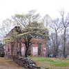 Biggin Church Ruins<br /> <br /> Biggin Church Ruins are the remains of the parish church of St. John's Parish. The church was established by an act of the South Carolina Commons House of Assembly in 1706, which divided the colony into ten parishes. The original Biggin Church was probably completed ca. 1711. Biggin Church was used through the mid-nineteenth century and the surrounding cemetery is still being used. During the American Revolution, ammunitions were stored in the church by British troops who, upon leaving, set the church on fire. The church was burned several other times throughout its use, the last time in the late 1800s when it was not subsequently rebuilt. For many years the site served as a local brickyard. Although only portions of two walls remain, there is evidence that originally Biggin Church was designed with a degree of sophistication. Notable architectural details which remain include a Gibbs surround at the main portal, quoins at the corner, radiating voussoirs over the windows, and a rounded water table—all executed in brick. Listed in the National Register December 13, 1977.