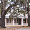 Otranto Plantation<br /> <br /> Architecturally, the house at Otranto is unlike any other surviving plantation house in the South Carolina lowcountry. The house is a one-and-one-half-story building, built low to the ground, a modified rectangle in shape, with an attached colonnaded piazza or porch on three sides. Exterior walls and columns are stuccoed brick. The gable ends have a low parapet with a course of brick as the cornice. Its construction date is undocumented, but it has been speculated that the house was constructed in the early Colonial period, because it is similar to early houses in Charleston. Mention of the house is made in a 1778 deed in which Dr. Alexander Garden conveyed the property to trustees for his wife and son. Construction of the house around 1790 is attributed to Dr. Garden, who bought the plantation in 1771. Garden was one of the most important scientific figures of colonial South Carolina. He was a leader in the fields of medicine, botany, and natural science, and the Gardenia was named for him. The plantation is first called Otranto, a literary name attributed to Horace Walpole's gothic novel The Castle of Otranto published in 1764, in a deed of 1785. In 1934 a fire occurred, damaging a portion of the exterior and destroying the interior of the structure. The home was meticulously restored based upon photographs of Otranto Plantation before the fire. The yard contains a small frame servants' house of undetermined age. Listed in the National Register February 17, 1978.