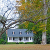Ulmer-Summers House<br /> <br /> Significant as one of the few examples of late eighteenth century domestic, folk architecture still extant in this region of the state, the Ulmer-Summers House was originally constructed on land granted to John Jacob Ulmer in 1757. The earliest section of the Ulmer-Summers house was built before the turn of the eighteenth century at the edge of a millpond. The house was probably a dogtrot when first built. In 1852, it was decided that the site near the millpond was dangerous to the health of the house's inhabitants and Ulmer was ordered to destroy the pond's dam. Before doing so, he moved the house to another tract of land approximately one mile away and renovated the house simultaneously. Set on a low brick foundation, the Ulmer-Summers house is a clapboard frame structure. The medium-gable roof projects over the front elevation and the porch is supported by two square columns, in antis; porch walls are shiplap. The three pedimented dormers and the double tandem stair were added during remodeling in 1960. For a period in excess of 200 years, the Ulmer and Summers families cultivated the land surrounding their house, raising indigo, cotton and grain. In the late nineteenth century, David Summers planted a grove of pecan trees and developed the project into a thriving business—Golden Kernel Pecan Company—that, at the time of nomination, is still in operation. Listed in the National Register October 25, 1973.