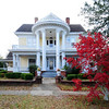 Colonel J.A. Banks House<br /> <br /> The Colonel J.A. Banks house was built ca.1893 as a residence for South Carolina State Representative and State Senator Col. J. A. Banks, and rebuilt in 1909-1910. According to an early photograph, the original house was one-story with a gable roof, two interior chimneys, and a porch spanning the breadth of the façade. With the 1909-1910 remodeling, the house took its present form. The house is significant both as a free interpretation of Classical and Victorian elements, and for its association with a locally prominent individual. This unique house was composed in the exuberant fashion common to the early twentieth century. The building incorporates certain features of the residual Queen Anne style - the asymmetrical plan, the variegated roofline, and multiple textures. Significant architectural features include: two Neo-Classical colossal Corinthian porticos; the juxtaposition of the colossal order with the lesser Ionic order on the façade; the concave recess of the second floor façade balcony, in response to the convex colossal portico; the gable pediments with Palladian windows; the elliptical arch of the stair hall; and the original leaded and beveled windows and mirrors. Two one-story, weatherboarded outbuildings are included in the nominated property: a fowl house and a workshop. Listed in the National Register January 24, 1980.
