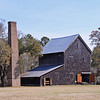 Chicora Wood Plantation<br /> <br /> (Matanzas Plantation) Architecturally, Chicora Wood is an outstanding early 19th century plantation home. Mounted on the typical raised basement used throughout the Southern coastal area for increased ventilation, the two-story clapboard house has lines that are simple and of diminutive proportions. Slender Doric columns and delicate balustrade adorn the façade. A one-story porch extends around three sides. There is a later roof dormer with a Palladian window. Interior woodwork, obviously the product of skilled craftsman, reflects the simple architectural designs of the exterior. The plantation itself was begun sometime between 1732 and 1736, with the house built before 1819. The house also has military, agricultural, industrial, political, social/humanitarian, educational and literary significance through its association with Robert F.W. Allston, member of the SC House of Representatives, a parish Senator, and Governor from 1856-58. Allston was considered to be the most notable planter on the Pee Dee River. Chicora Wood served as home plantation for Allston's complex of rice plantations which produced 840,000 pounds of rice in 1850 and increased to 1,500,000 pounds by 1860. The slave labor force which produced the rice numbered 401 in 1850, increasing to 630 by 1860. The plantation complex includes a number of excellent outbuildings: original kitchen, smoke house, and a later carriage house, wash house and farm buildings. The rice mill complex, one of the most interesting remaining examples of its type, includes the mill and shipping house. Listed in the National Register April 11, 1973.