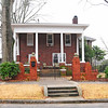 Colonel Elias Earle Historic District<br /> <br /> The Colonel Elias Earle Historic District is significant for its mixture of early twentieth century architecture. The district was originally part of the estate of Colonel Elias Earle, a prominent early nineteenth century Greenville citizen. After 1900, the area was subdivided into residential lots and houses began being built in the area soon afterwards. Following the demand for textile products during World War I, Greenville experienced a building boom and the James-Earle Street area became a major middle class neighborhood. Most of the homes in the district were built during the 1920s by businessmen who prospered in the post-war era. The district contains excellent examples of Colonial Revival, Bungalow, Neo-Classical and Tudor Revival housing as well as many vernacular forms. The district contains eighty-seven properties of which a large percentage are residential. The district is well intact with few intrusions and most buildings share uniform setback. The majority of the district's buildings were constructed between 1915 and 1930 and are one to two stories in height, of brick and frame construction. Listed in the National Register July 1, 1982.