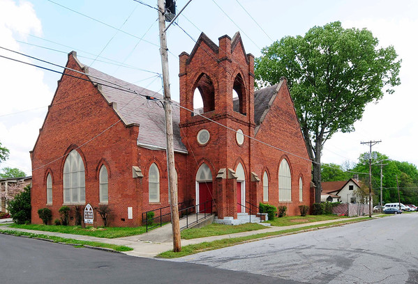 Mount Pisgah A.M.E. Church<br /> <br /> Mount Pisgah African Methodist Episcopal Church is a late interpretation of the vernacular ecclesiastical architecture of the last two decades of the nineteenth century. Exemplary of the widespread growth of independent black churches which occurred in the South both during and after Reconstruction, Mount Pisgah A.M.E. Church has been an important influence on the religious and educational life of the black community of Greenwood. Erected in 1908 in the Gothic Revival style by members of the congregation, the brick church features typical Gothic details and is set on an enclosed basement. Architectural features of note include the steep, cross gabled roof with stepped end gables, the asymmetrical massing of the porch and tower, the 1/1 Gothic center pointed stained glass windows, the auditorium plan, and the flat coved ceilings of the interior. The interior is basicly symmetrical in plan and is exemplary of the auditorium form which was derived in the 1880s and 1890s to meet the needs of American Protestant worship. The original pulpit, altar, and balustrade with turned balusters and newel posts remain. The curving pews date to the 1880s and are not original to the church. Listed in the National Register August 16, 1979.