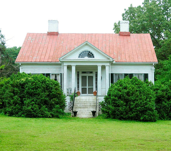 Allen Dial House<br /> <br /> (The Valley; Cedar Valley Farm) The Allen Dial House, built ca. 1855 by Allen Dial, is the best example of mid-nineteenth century Greek Revival raised cottage architecture in Laurens County. It is a vernacular interpretation of the Greek Revival style, translating the design to suit the upcountry climate, building materials, and methods. The house is built on a high stuccoed masonry foundation, which forms the basement story. The rectangular one and one-half story house is sheathed in narrow width weatherboard with flush board under the front and rear porticos. The façade has as its central feature a pedimented portico supported by four paired and fluted pillars. The portico tympanum has a fanlight style lunette. The door surround is composed of a pilastered ornamental architrave with decorative corner blocks and features an unusual grid designed glass and molding transom and sidelights. The home has a metal-covered gable roof and has a landscaped garden. The formally landscaped boxwood garden is further refinement of the Greek Revival style. A rectangular one-story outbuilding, originally a kitchen, stands about six feet to the west of the house. Additionally, one outbuilding, a log structure reputedly contemporary with the house, stands at the southwest side of the house. Allen Dial (1811-1894) was a successful farmer, a self-taught doctor, and a leader in Chestnut Ridge Baptist Church. Listed in the National Register January 21, 1982.