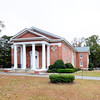 Providence Methodist Church<br /> <br /> Providence Methodist Church, constructed in 1919-20, is significant architecturally as an outstanding and remarkable example of an early twentieth-century Neo-Classical sanctuary in rural lower South Carolina. The church was designed by the renowned Columbia, South Carolina architect Charles Coker Wilson, one of the most successful and influential South Carolina architects of the early twentieth century. The church building, inclusive of the sanctuary and rear educational/administrative wings, is laid out in a slightly modified cruciform plan and features a gable-front, temple-form, edifice with a central tetrastyle portico, simplified Roman Doric order limestone columns, pilasters and entablature, a boxed cornice with pedimented gables, numerous bull's eye windows, and remarkable large stained glass Palladian windows. In particular, its outstanding sanctuary windows, which church members insist were purchased from Louis Comfort Tiffany's studio at the time of construction, make the church a noteworthy property combining Wilson's fine church architecture with outstanding examples of early twentieth-century art glass. To the rear of the church is a large cemetery that contributes to the significance of the property. It contains the burial plots of more than 400 parishioners and community members dating to 1856, though fewer than fifteen individuals were buried there prior to 1880. Listed in the National Register September 25, 2009.