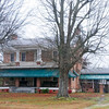 Hurricane Tavern<br /> <br /> (Workman Farm) Hurricane Tavern is a rural farmstead containing a brick farmhouse built ca. 1811 with major alterations and additions ca. 1850 and ca. 1920, an 1885 frame farmhouse, a ca. 1924 country store, a collection of twenty-seven intact late nineteenth and early twentieth century agricultural outbuildings, a ca. 1948 ten-acre agriculturally-related lake, and approximately 250 acres of historically terraced agricultural fields. The principal residence is a significant example of a vernacular interpretation of Federal period residential architecture, also demonstrating its evolution over time by its vernacular interpretation of the Craftsman style in its early twentieth century addition. The interior details of the ca. 1811 Federal portion are highly decorative and are fine examples of a vernacular interpretation of the Adamesque style, while those of the ca. 1920 Craftsman addition incorporate many design elements echoing and complementing the interior of the ca. 1811 house. Hurricane Tavern and its collection of agricultural outbuildings are also significant as a significant local center of agriculture, commerce, and social activity for much of the twentieth century. Listed in the National Register July 19, 2001.