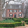 Nicholls-Crook House<br /> <br /> This two-story brick house was constructed ca. 1800 by Jesse Crook, a Spartanburg County planter. Elements of 18th century architecture are evident in the style of the house and as such they are significant for their early appearance in Upcountry South Carolina plantation residence design. The house shows influence of Virginia architecture, particularly the Flemish bond brickwork, the chamfered brickwork of the chimneys, the Georgian symmetry in the three-bay façade, the segmental arches over windows and doorways, the wide windows of the front and rear facades, and the joined chimneys of the eastern façade. The Virginia architectural influence can be traced to the fact that James Crook, father of the builder, was born in Mecklenburg County, Virginia in 1746 and moved to the Spartanburg District just prior to the Revolution. Wooden additions were added in the nineteenth century, but have since been removed or deteriorated. The interior includes large fireplaces and an original hand-carved mantel. The full basement, which was used as domestic slave quarters, has an earthen floor and large fireplace. Listed in the National Register March 20, 1973.