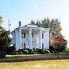 """J. Clinton Brogdon House<br /> <br /> Built in 1911, the J. Clinton Brogdon House is significant as a representative example of the Neo-Classical style, popular from ca. 1900 to ca. 1920. Buildings of this style emphasized hipped roofs, and elaborate, correct columns. The full façade front porch is supported by six unfluted columns with Ionic capitals. It is one of the few Neo-Classical examples in Sumter County and may be a rare example of a mail order house in the area. According to the family, the materials for the house all came from Hickory, NC, delivered by rail. The price of $5,500 paid for the materials is comparable to the cost of the top-notch Sears & Roebuck house, """"The Magnolia,"""" a Neo-Classical house which was advertised in 1918 for $5,140 to $5,972. The area around the house is known locally as """"Brogdon"""" or """"Brogdon Station."""" The J. Clinton Brogdon House is one of the last vestiges of this rural neighborhood. It is a well-preserved example not only of the Neo-Classical style as manifested in South Carolina, but a reminder of the importance of rural neighborhoods such as Brogdon Station, where transportation paths crossed and commercial goods could be exchanged. Listed in the National Register July 1, 1993."""