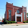 Temple Sinai<br /> <br /> Temple Sinai is a significant example of a sanctuary designed in the Moorish Revival style. It is also a visible symbol and tangible reminder of the substantial and influential Jewish community in Sumter from the early nineteenth century to the present. As the center of that community, its impact and influence were widespread. Outside the coastal cities of Charleston and Georgetown, where there were well-established and significant Jewish populations dating to colonial days, Sumter's Jewish community was one of inland South Carolina's largest. Congregation Sinai grew out of the formation of several societies in Sumter in the mid-nineteenth century. By 1895, the Sumter Hebrew Benevolent Society and the Sumter Society of Israelites merged under the name of the Sumter Society of Israelites. Between 1895 and 1904, the society purchased a lot on the corner of Church Street and West Hampton Avenue as the site for a synagogue. By 1906, the congregation had constructed a wood-frame building. The second, and present, brick sanctuary was built ca. 1910-17. Listed in the National Register January 21, 1999.