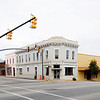 Kingstree Historic District (Wee Nee Bank)<br /> <br /> The Kingstree Historic District contains forty-eight properties situated along Main Street, Academy Street, and Hampton Street in the commercial area of downtown Kingstree. The district includes the courthouse, public library, railroad station, and numerous commercial buildings. The district is a fine collection of nineteenth-century vernacular commercial architecture. Details such as arched doorways and windows, cast-iron columns and pilasters, decorative or corbelled brick work and pressed tin interior ceilings are present on most of the district's buildings. The Williamsburg County Courthouse, built ca. 1823, and designed by Robert Mills, is a fine example of Roman Neo-Classical design with its raised first floor, pediment with lunette, and Doric columns. In 1953-54 the courthouse underwent substantial remodeling on the exterior and interior, though it still reflects much of Mill's original design. With the exception of the courthouse, most of the buildings in the district were built between 1900 and 1920 when Kingstree enjoyed prosperity as a retail and tobacco marketing center of Williamsburg County. The majority of the buildings in the district are a visible record of this twenty-year growth and the historic fabric of the area remains substantially intact. Listed in the National Register June 28, 1982.