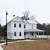 McCollum-Murray House<br /> <br /> (C.E. Murray House) The McCollum-Murray House, constructed ca. 1906, is significant as the long-time residence of and most intact historic resource associated with the productive and professional life of Dr. Charles Edward Murray, one of Williamsburg County's and South Carolina's most significant educators of the mid-twentieth century. Murray was quite possibly the first African American in South Carolina to be honored by having a school named for him, and was also the first active school principal in South Carolina to have a school named for him. In addition the house is significant for its importance to the African American community in Williamsburg County and as an excellent and intact local example of transitional folk Victorian and Classical Revival residential architecture. The McCollum-Murray House, a substantial home in a small South Carolina town built at the turn of the twentieth century for a successful African American couple, Edward J. and Margaret McCollum, by an African American builder, George Whack, is a rarity for its time and place. The house was originally constructed as a two-story, T-shaped or gable front and wing dwelling with a single-story porch on the front. Early in the history of the house a single-story rear gabled addition was constructed, followed by another single-story shed-roofed addition to the east of that in the 1950s. The metal roof is cross-gabled in form with full cornice returns or pediments in all the gable ends. The front porch wraps around to the east, has a shed roof, and is supported by square paneled pillars. Listed in the National Register July 11, 2006.