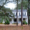 "Salters Plantation<br /> <br /> The Salters Plantation House is an important example of nineteenth century domestic architecture combining national, regional, and local architectural trends. It was built by William Salters not long before his death in 1833 and has been added on to many times since. The Greek Revival influence in its detailing coexists well with the symmetrical I-house pattern typical of the inland and upper South. The front ""rain porch,"" supported by six stuccoed brick columns on squared brick bases, is a regional feature associated with eastern South Carolina and the Pee Dee. Behind the main house are the domestic outbuildings: a small frame house that was connected to the main house as a kitchen until 1959, a ca. 1947 playhouse, and a ca. 1915 one-car garage. Further back are the farm buildings: a ca. 1890 commissary, a storage barn and a tobacco pack barn. Built for a successful planter who was a prominent citizen in early Williamsburg District, the house, at the time of nomination, remains occupied by his descendents. The house is also significant for its association with Captain John Alexander Salters (1815-1898), the successful planter, S.C. representative and only son of William on whose land Salters Depot was established, leading to the development of the town of Salters. Listed in the National Register June 2, 2000."