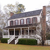 "Thorntree<br /> <br /> (Witherspoon House) The oldest known residence in the Pee Dee area, Thorntree is an excellent example of the earliest plantation houses constructed entirely of native materials. Built by Irish immigrant James Witherspoon in 1749, the house possesses a progressive rural domestic design. The house was located in the wilderness and adapted to the New World, but with refinements recalling the good life in the Old World. The two-story frame ""I-House"" type house has a hall and parlor plan with exterior end chimneys, and full-length piazzas on the front and rear elevations. Its brick piers support hand-hewn heart pine beams. All twenty-four windows have pine paneled shutters fastened with hand-forged strap hinges. The entire interior is pine: the floors, walls, ceilings, cornices, mantels and all overmantels (except two that are plastered). The house was moved from an inaccessible rural site to preserve it. The original site was unavailable for purchase, and unprotected against fire and vandalism. The present site is within the city on land donated as a memorial park. Victorian trim, south piazza, and shed rooms added ca. 1800 have been removed. The house now stands as it was in the eighteenth century. Listed in the National Register October 28, 1970."