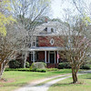 Harbison College President's Home<br /> <br /> The President's Home of Harbison College is located in a residential area on the outskirts of Abbeville, South Carolina. The house is significant to black history and to education for its association with Harbison College, an institution of higher education for black students, which was established by the Presbyterian Church in the United State of America. The two-story brick four-square house was built in 1906-07 to serve as the residence of the college president and is the only remaining building of the Abbeville campus of Harbison College. From its incorporation in 1901 until it moved from Abbeville in 1910, Harbison College was a co-educational institution offering a liberal arts education combined with religious, industrial, and agricultural training –one of the few such colleges for blacks in South Carolina. The President's Home of Harbison College is situated on the crest of a ridge on a three-acre tract of land that was part of the original 65-acre Harbison College campus. A large front yard separates the house from South Carolina Highway 20. Several outbuildings, including a brick privy contemporary to the house, are located in the back yard. Listed in the National Register January 13, 1983.