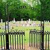 Lindsay Cemetery<br /> <br /> Lindsay Cemetery, established ca. 1820, is significant as the first cemetery in the Due West vicinity of what was then Abbeville District, and for its association with seventeen prominent early families of Abbeville District (later Abbeville County), from the early through the late nineteenth centuries. It is also an excellent intact example of an early-nineteenth through early-twentieth century cemetery reflecting typical burial customs and gravestones of the period. Lindsay Cemetery contains approximately 107 graves with inscriptions, approximately sixty graves marked with stones or rocks, and an unknown number of unmarked graves. The marked graves are predominantly headstones and footstones, most of them marble tablets although obelisks and table-top tombs are also present. The earliest marked grave is from 1820 and the most recent marked grave is from 1927, but most graves date from 1829 to 1892. The stones are arranged for the most part by nuclear or extended family units within the cemetery boundaries, but without formal stone, brick, or iron plot enclosures. The cemetery is enclosed by an elaborate four-foot high cast iron fence featuring Gothic pointed arches, spearpointed top rail, and large floral finials decorating its four corners. Listed in the National Register May 27, 2009.