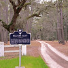 Willtown Bluff<br /> <br /> (Wilton; New London) Willtown was the second planned town to be established after the relocation of Charleston in 1682. It was one of two South Carolina precincts prior to the 1706 Church Act, and after that date served as a local governmental center (polling place, court of pleas, magistrate court). It was militarily important in the protection of the frontier and served as a regional commercial center. Willtown was located on a 25 foot high bluff overlooking the South Edisto River, called the Pon Pon River in the 18th century. The town site is almost all level, its lawn interspersed with large oak trees. Only the northern section is wooded and three early-nineteenth century buildings are located on the cleared portion: the ca. 1836 Parsonage, the ca. 1820 Willtown Plantation House, and the remains of a single column of the ca. 1836 Episcopal church. Unexposed remains are of a colonial village thought to have had 80 houses. The town was divided into 62 blocks with most having four one-acre lots. There were 17 streets with blocks set aside for an Episcopal church and a school. A market and a town garden were also provided locations. Listed in the National Register January 8, 1974.