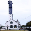 U.S. Coast Guard Historic District<br /> <br /> The Sullivan's Island Coast Guard Station is the oldest extant life saving installment on the South Carolina Coast. Shortly after the Civil War, the Federal government recognized its obligation for the personal safety of citizens in the port area of Charleston with the establishment of the now defunct Morris Island Station. When the main shipping channel into Charleston was altered about twenty years later, the citizens of the immediate area indicated their reciprocal acceptance of that principle. In 1891 the nearby summer village of Moultrieville deeded five acres of land to the United States government for the express purpose of establishing a life saving station and again in 1896 an additional acre to compensate for loss of land by erosion. All of the contributing properties in the district are located behind the primary dune. The station house/administration building (ca. 1891), boathouse (ca. 1891), garage (ca. 1938), and signal tower (ca. 1938) are laid out in an L-shaped court loosely organized around the bunker/sighting station (ca. 1898). The non-contributing lighthouse (ca. 1962) lies nearest the ocean. Listed in the National Register June 19, 1973.