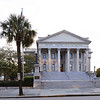 """U.S. Post Office and Courthouse<br /> <br /> By virtue of its location on the """"Four Corners of the Law"""" the United States Post Office and Courthouse in Charleston is an important structure. A 1792 courthouse represents county government, while the City Hall, begun in 1800, symbolizes city government. St. Michael's Church, built between 1752 and 1761, depicts ecclesiastical law. Completing the foursome is the 1896 Post Office, representing the federal government. Although nearly a century separates them, the Renaissance Revival structure is compatible with the three earlier buildings, and is an appropriate expression of the late nineteenth century. The architect for the building was Will A. Freret, who served as Supervising Architect of the Treasury in 1887 and 1888. Built of Winnsboro granite, the Post Office borrows elements from various Renaissance Revival styles. Dark and light stone heightens the contrast between the rusticated basement and first floors and quoining, and the smoother wall surfaces of the two upper stories. The main façade is broken into five advancing and receding planes. A pedimented central block denotes the main entrance. Listed in the National Register August 13, 1974."""