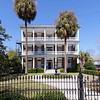 Robert William Roper House<br /> <br /> The Roper House was the first to be constructed on the east Battery (ca. 1838) and its outsized colonnade was built not only to support the portico, but to be admired from across the harbor. The house is typical of its period in that it is built on a grandiose scale, but is more so than almost any other private dwelling in the city. The house is two stories over a basement, built of brick in Flemish bond, and has a flat, balustraded roof with an Ionic entablature. The portico is giant-order Ionic pentastyle above a ground-floor arcade of stuccoed brick. The five-columned portico is an unusual feature in Greek Revival buildings in the state. Unlike most Charleston houses, the Roper House portico does not have a second-story tier to break the height of the columns. Another unusual feature of the house is that the roof of the house proper and that of the portico are incorporated into a single unit; this treatment was not generally found during this period in the state. Although records have been destroyed, the detail of the house would point to E.B. White as its architect. Listed in the National Register November 7, 1973; Designated a National Historic Landmark November 7, 1973.