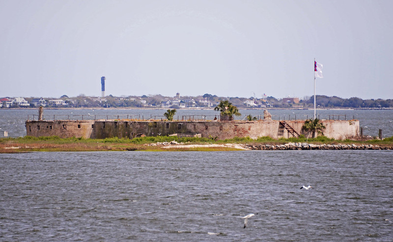 """Castle Pinckney<br /> <br /> Typical of the castle-type fortresses which guarded important early settlements, but which lost their effectiveness with the improvement of explosive shells and the development of rifle pieces, Castle Pinckney is believed to be possibly the only horseshoe fort left in America which can be restored. The fort is a Charleston Harbor landmark and is historically interesting because it existed for such a long period of time, reflecting a number of colorful and significant events from the Colonial through the Confederate periods. The crescent-shaped, castle-type bastion on Shute's Folly, a mile offshore East Battery, Castle Pinckney was constructed 1808-1811 as an inner-harbor, secondary defense fortress. The island's name reflects a later owner, Joseph Shute, and preserves the Colonial custom of describing a Carolina sea island as a """"folly."""" The fort was named for Charles Cotesworth Pinckney, a Charlestonian and President Washington's Ambassador to France, famous for his stand against the United States payment of any tribute. Castle Pinckney was the first ground seized by the Confederate military, accomplished on December 17, 1860, an act some historians claim as the first overt act of war. Listed in the National Register July 16, 1970."""