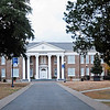 Davidson Hall, Coker College<br /> <br /> Davidson Hall, located on the campus of Coker College, was constructed ca. 1909-1910, with funds donated by the college's founder, Major James Lide Coker. Major Coker, noted Hartsville industrialist, merchant, banker and agriculturalist, founded Coker College to provide quality education for women and to extend cultural opportunities to the Pee Dee region. Davidson Hall is significant for its association with Major Coker's philanthropy and it is important in the history of education in the Pee Dee. It was the first building constructed for Coker College and it became the symbol of the school; its façade is incorporated into the college seal. Designed by the prominent South Carolina firm of Wilson, Sompayrac, and Urquhart, the two-story, brick educational building is enhanced by Neo-Classical details and stands out as one of Hartsville's finest buildings. The hall is a rectangular plan brick building laid in common bond. It has a hip roof and a projecting semicircular auditorium on the rear elevation. The central portion of the fifteen bay façade features a projecting, two-story, pedimented portico, which is supported by six stuccoed Ionic columns with scamozzi capitals. A cornice embellished with dentil molding encircles the entire building. Listed in the National Register November 10, 1983.