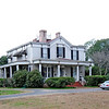 Wilds-Edwards House<br /> <br /> (Col. Samuel H. Wilds House) The Wilds-Edwards House is significant as one of the few relatively intact antebellum residences remaining in the city of Darlington and as a locally important example of Italianate style. The house is primarily defined by its massive square form, square paneled chimneys, one-story Corinthian columned porches, and profusion of Italianate details. The sophistication of its massing and command of classical details alludes to the formal training of its architect, J.L. Klickner. Built ca. 1856 by Col. Samuel H. Wilds, the Wilds-Edwards house rests on a high masonry foundation. Square in plan, the wood frame residence has a symmetrical roof plan, in the center of which is a square pedestal that may have once been the base of a belvedere or a widow's walk. Three massive stuccoed chimneys project through the roof. On each elevation there is a one-story porch, the back porch having been partially enclosed ca. 1905 for a kitchen. About 1905, after the creation of Edwards Avenue to the east, the house was modified to have its principal entrance on the east side. Behind the house is the original 19th century kitchen. The house was purchased from the Wilds estate in 1870 by the Hon. Berryman Wheeler Edwards, a prominent Darlington attorney and county senator. His son, Charles B. Edwards, a mayor of Darlington, added electric lights and the arch in the east hall about 1905. Listed in the National Register February 10, 1988.