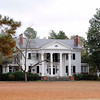 Lydia Plantation<br /> <br /> Lydia Plantation is significant as an intact architectural collection of mid-nineteenth and early twentieth century historic farmstead resources that reflect the succession of occupants' collective influence on the cultural, social, and economic growth of the Pee Dee region. The nominated property, including the historic house, landscaped avenue and garden, historic outbuildings, and core of the historic farmstead, now about 16 acres, contains eighteen contributing historic resources and one modern noncontributing resource. The main residence, built in 1910 and altered in 1920, is an excellent example of Neo-Classical residential architecture in the rural Pee Dee region, and is representative of the quality of design and workmanship carried out by the distinguished Columbia architect Charles Coker Wilson and his firm of Wilson, Sompayrac & Urquhart. The property also contains a ca. 1850 sixteen-sided frame medical office, two ca. 1850 octagonal frame outbuildings, a ca. 1850 side-gabled frame outbuilding, an early twentieth century wading pool which now serves as a goldfish pond, two designed landscapes, a frame playhouse, and two frame garages. There are also three late nineteenth century agricultural outbuildings, consisting of a frame barn, tobacco warehouse, and seed house. The portion of the property across the road from the dwelling contains a frame farm office, store, pump house, storage building, and night watchman's house. This portion additionally contains the one noncontributing structure, a large equipment shed, which stands on the site of a large dairy barn (ca. 1875) that burned in the late 1960s. Listed in the National Register May 28, 2010.