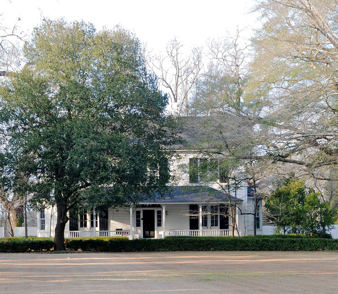 E.W. Cannon House<br /> <br /> The E.W. Cannon House and Store are significant as representative examples of the residential and commercial development of Hartsville prior to 1890 and for their association with Elihu W. Cannon (1841-1911), prominent Hartsville farmer and Darlington County politician. The house has architectural integrity from ca. 1880 and incorporates a small one-story ca. 1840 residence built for Isham Linton that now serves as a rear wing. Cannon substantially altered and enlarged the house ca. 1880, and lived here until his death. This two-story residence is of frame construction with weatherboard siding. It has a rectangular plan, lateral gable roof, and two interior ridge brick chimneys with corbeled caps. A one-story hip roof porch extends across the full façade. The store is located to the rear of the house. Constructed ca. 1870, it is an excellent example of a country store. It is one-and-one-half stories with a rectangular plan and gable roof. The construction is hand-hewn heavy timber frame with log joists and it sits on pole piers. It also served as a post office from 1873 to 1878, when Cannon was Hartsville's postmaster. The property also includes a ca. 1930 frame garage and a ca. 1880-1900 frame smokehouse. Listed in the National Register May 3, 1991.