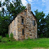 Old Stone House<br /> <br /> The Old Stone House is significant as a rare example of eighteenth-century stone construction. Samuel Gladney (ca. 1740-1800) received a royal land grant in 1768 on which he constructed the Old Stone House. A corner of the house bears the date 1784. The house passed through several owners before it was purchased in 1870 by the Lebanon Presbyterian Church for use as a parsonage. The house is a two-story, side-gable roofed, stone building, with a double-pile floor plan and end chimneys of stone. The front porch foundation and stone piers remain, although porch roof and supports have been removed. The façade has a central door with a massive stone lintel flanked by single four-over-four windows with stone lintels. The second story has three four-over-four, shuttered windows. The rear elevation has an off-center entrance flanked by two single windows. The second story has two four-over-four windows and a third that has been filled with stone. The roof is covered with metal. December 6, 1984.