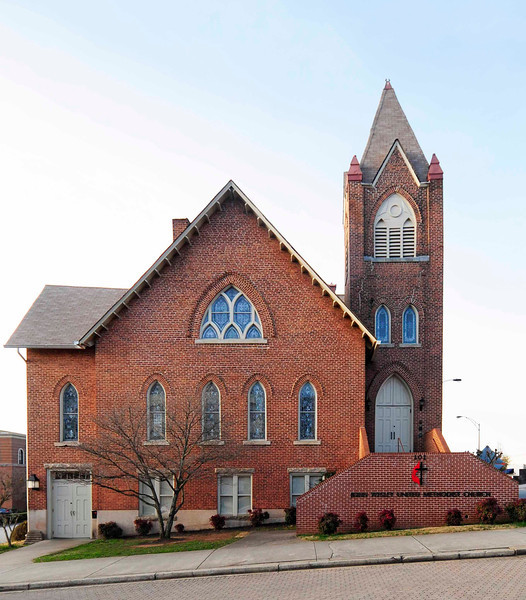 John Wesley Methodist Episcopal Church<br /> <br /> Built between 1899 and 1903, the church is a two-story structure of brick laid in standard bond, a vernacular version of the Gothic Revival style of church architecture. The style is characterized here by irregular massing, regular fenestration with emphasis on pointed arch windows with tracery, pinnacles and other decorative motifs on accent points (such as the tower), gables and steeply sloping roofs, large major interior space with emphasized height, beaded ceilings and wainscoting, wooden floors, and stained glass ornamentation. After the Civil War, the Methodist Episcopal Church sent preachers and teachers to work among freedmen in the South. At a meeting in Charleston, it was decided to establish a congregation in Greenville, and in 1866 John Wesley's congregation was organized by the Rev. J.R. Rosemond under the name of Silver Hill Methodist Episcopal Church. Initially, the congregation met in a building owned by a white congregation, but after voting to affiliate with the Methodist Episcopal Church, North, rather than the Methodist Episcopal Church, South, the congregation acquired a log building on Ann Street. Alexander McBee subsequently donated a lot at Choice and Cleveland Streets, where a structure was built and occupied by the congregation until 1900. The foundations of the present structure, at East Court and Falls Streets, were laid in 1899 and the sanctuary was dedicated in 1903. Listed in the National Register January 20, 1978.