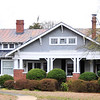 McDowell House<br /> <br /> The McDowell House, built ca. 1922, is architecturally significant as an excellent local example of a Craftsman style bungalow. The house features shingle siding in its gables, a side-gabled main body with projecting front cross-gabled porch with triangular knee brackets, exposed rafter tails under wide overhanging eaves, pairs of wood pillars on brick pedestals, a pergola, and interior details that include original wood flooring, window and door surrounds, fireplace surrounds and mantels, trim, and detailing. The walls are covered with weatherboard siding and the roof is covered with standing seam metal. The craftsmanship, attention to detail, and knowledge of the cross-gabled Craftsman house form is reflected in J.B. Wasson's construction. Wasson milled the pine and oak on his property in the Fairview Community of Fountain Inn for the house that he built for his sister, Quentine Wassoon McDowell, the widow of James Wistar McDowell. The property includes a one-story front-gabled contributing outbuilding, built ca. 1922, that was originally used as a garage, as well as a ca. 1950 one-story front-gabled noncontributing outbuilding and a ca. 1984 noncontributing swimming pool. The addition of the second floor half-story under the existing historic roofline occurred in the 1980s. Listed in the National Register November 17, 2010.