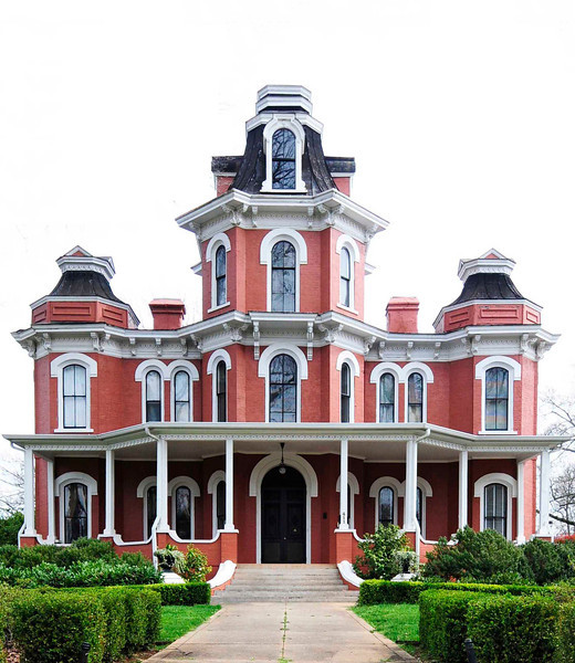 Lanneau-Norwood House<br /> <br /> The Lanneau-Norwood House is an outstanding example of the Second Empire style and is associated with prominent residents of Greenville. The house is a two-and-one-half story brick mansion built for Charles H. Lanneau ca. 1877. The symmetrical façade features a central pavilion and tower and projecting corner pavilions. The tower is octagonal in shape and extends one and one-half stories above the cornice line of the main block of the house. A one-story front porch extends the full width of the façade and projects outward from the corner pavilions. The porch includes slender posts with scrolled brackets, a decorative cornice, and balustrades at roof level. The windows have round-arched lintels and granite sills. Lanneau organized the Hugenot Plaid Mill which was constructed in 1882. The house and associated parcel were acquired by John Wilkins Norwood from the Lanneau estate in 1907. Norwood was a prominent banker and businessman known for his contribution as a leading financier of the growing textile industry in North and South Carolina. The nominated property includes three outbuildings: a two-room, one-story brick servants' quarters with a gable roof, a brick garage, and a small greenhouse. Listed in the National Register July 1, 1982.