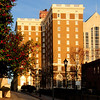 Poinsett Hotel<br /> <br /> The Poinsett Hotel was one of the first skyscrapers to be constructed in Greenville. Named after Joel R. Poinsett, the Secretary of War under President Fillmore, the hotel was built on the site of the Mansion House, an 1824 resort hotel. Built in 1925 at a cost of 1.5 million dollars, the Poinsett Hotel was designed by William L. Stoddard, a New York architect, and built by the J.E. Sirrine Company of Greenville. The Poinsett is a twelve-story skyscraper with a narrow rectangular plan and an L-shaped façade. The façade is composed in three parts: a base, an intermediate shaft, and a capital. The four-story base is highlighted by tall arched windows that span the second and third stories. A wide cornice separates the base from the unornamented shaft. A broad frieze with terracotta festoons and urns between small transom windows is above the capital story windows. A full cornice with dentils and modillion blocks surmounts the frieze. A balustraded parapet is above the cornice. The Poinsett Hotel marks an era of Greenville's building boom and growth in the 1920s. The hotel featured a ballroom, a convention hall, a main dining room, private dining rooms, a grill room, a lounge, eight to ten shops and stores, and 210 guest rooms, each with a private bath. Listed in the National Register July 1, 1982.
