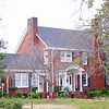 Robert G. Turner House<br /> <br /> The Robert G. Turner House, built in 1935, is significant as an excellent example of a Colonial Revival residence of the period and as an important residential design by prominent Greenville architect William Riddle Ward (1890-1984). Ward, an Alabama native, was educated at Auburn University and came to South Carolina in 1916 to work for Greenville architect Haskell H. Martin; he left Martin's firm in 1925 to go into independent architectural practice, and designed over one hundred residences in the state - including many in Greenville and Greenville County - by the time he retired in 1957. Ward was commissioned to design this house for Robert Gibbs Turner and his wife Mary after Mrs. Turner saw a Ward-designed house in Greenville and admired it. The house is divided into three distinct masses: a two-story, lateral gabled body, a single-height side-gabled porch, and a single-height side-gabled wing. The roof structure of all three, clad in composition shingles, features simple boxed cornices with ogee moulding. He also designed a one-story brick veneered garage for the Turners. Listed in the National Register February 1, 1999.