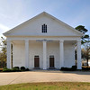 Fairview Presbyterian Church<br /> <br /> Organized in 1786, Fairview Presbyterian Church is one of the oldest churches in the South Carolina upcountry. Fairview Presbyterian Church was constructed in 1858 and is a white clapboard, two-story structure and is virtually original. The church exemplifies the Greek Revival style with its clapboard siding, square columns, and pedimented portico. Other features of the building, such as the twin entrances under the portico and the side doors which lead to the gallery, are also indicative of the meeting house style which frequently influenced rural churches. Original interior features still in use are the pulpit and pews, their feather graining intact. Although a one-story section was added to the rear in 1949 the building's architectural integrity has been retained. There have been four church buildings on the present site. According to church records, the third church was brick and was dedicated on August 11, 1818. This church was replaced by the present frame structure. Fairview's cemetery is significant in its own right, the oldest graves dating from 1797. There are graves of seven Revolutionary War soldiers, plus those of soldiers in later wars, as well as those of slaves. A fieldstone wall surrounds the cemetery. Listed in the National Register August 16, 1977.